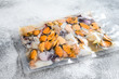 canvas print picture - Raw seafood mix in vacuum packaging. Gray background. Top view