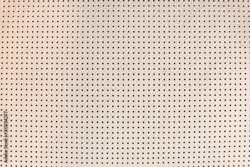 Fényképezés Light beige perforated leather texture close up