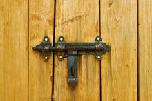 Iron Latch And Yellow Wooden G...