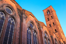 Basilica Of San Petronio (Basilica Di San Petronio) In Bologna, Italy - Rear Part With The Tower - At Sunset, Illuminated By The Last Rays Of Golden Light, Under Clear Blue Sky.