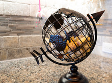 A Metal Globe Containing Used ...