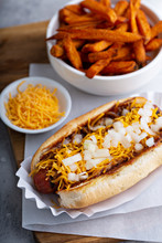 Chili Hot Dog Topped With Chee...