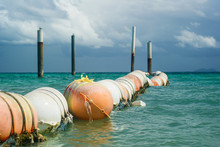 White And Orange Buoys And Pil...