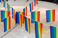 Rainbow Flags Hanging On Rope