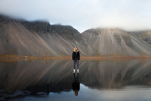 Woman Standing On Water With M...