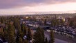 Aerial drone sunset backward flying of Bend Oregon with snow on ground