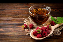 Cup Of Black Tea And Raspberry...