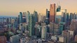 Aerial: Establishing shot of apartments & downtown Toronto city skyline at sunrise. Ontario, Canada.