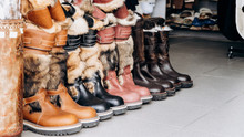 Warm Boots On The Counter Of T...