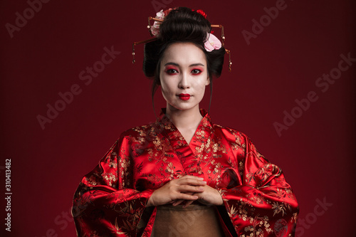 Image of beautiful young geisha woman in traditional japanese kimono Fototapet