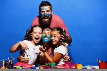 Parents And Children Painted W...