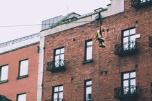 A Pair Of High Heels Hanging In A Phone Wire Cable