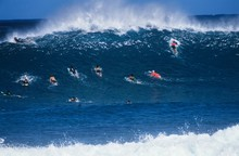 Surfers Paddling Out To Catch ...