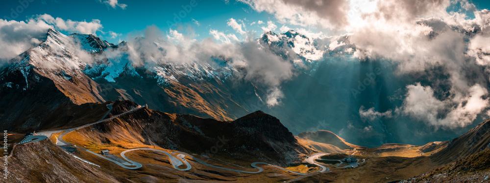 Obraz Panoramic Image of Grossglockner Alpine Road. Curvy Winding Road in Alps. fototapeta, plakat