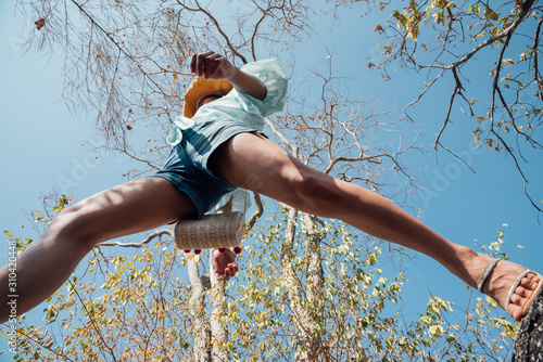 Woman jumping or crossing step over in forest Canvas Print