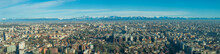 Aerial View Of Milan (Italy) With The Lombard Alps In The Background