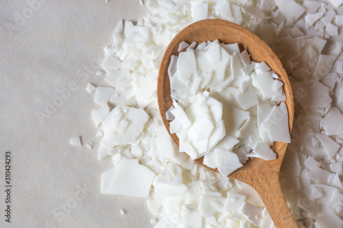 Fotografie, Obraz Close up of white soy wax flakes for candle making