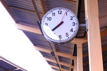 Big Clock Hang Under The Roof Of The Train Station For Passengers.