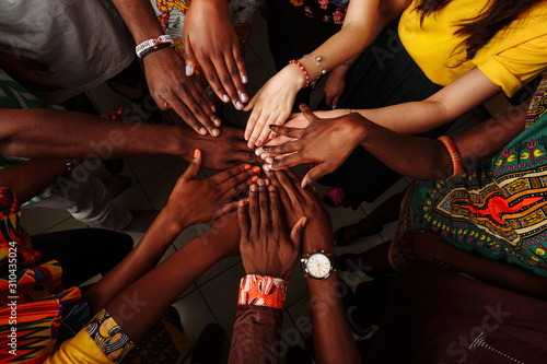 Fényképezés Hands of happy group of multinational African, latin american and european peopl