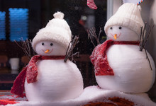 Close Up On Fluffy Christmas Snowmen Decorations In A Window