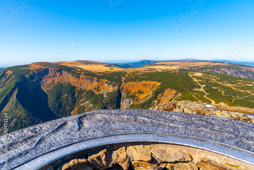 Fototapeta Studnicni Mountain and Giant Valley, Czech: Obri dul, on autumn sunny day in Krkonose - Giant Mountains, Czech Republic. View from lookout point on Snezka Mountain obraz