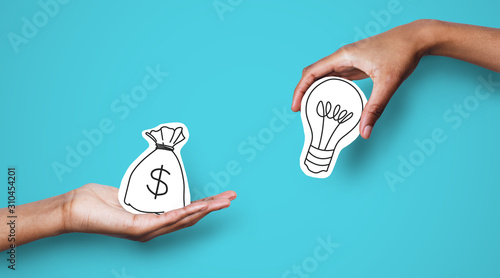 Fototapeta Hands with dollar sign bag and white light bulb obraz