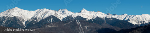 Panoramic view of snowy Caucasus mountains ridge at clear blue sky background at Wallpaper Mural