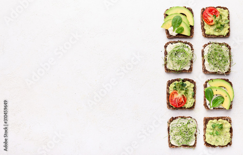Sandwiches with avocado, tofu cheese and microgreen