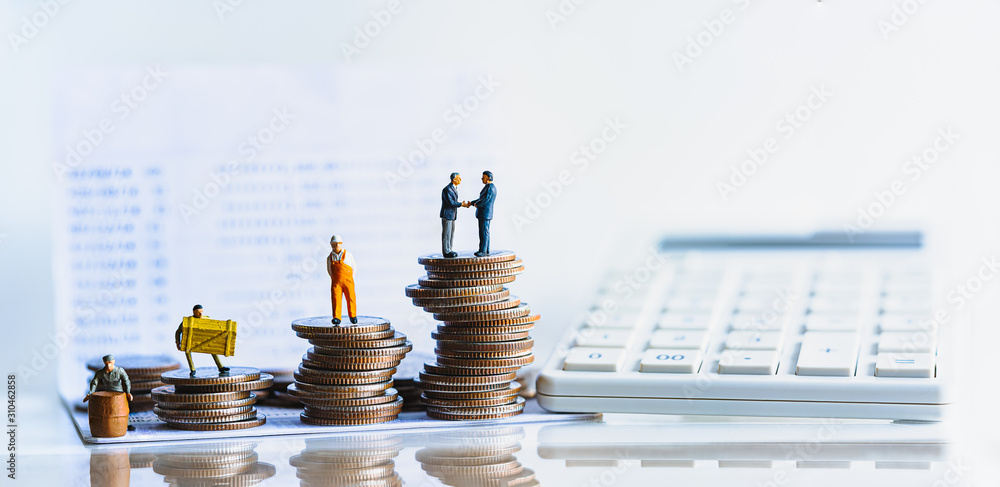 Fototapeta Miniature people standing on a pile of coins. Inequality and social class. Income and economic inequality concept. Inequality in social class, ideology, Gender, Racial and ethnic and health.
