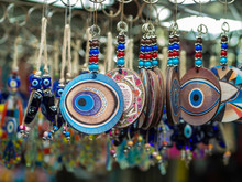 Evil Eye Protection Amulets In A Souvenir Shop Still Life With Macro Effect. One Of The Most Popular Arabic And Oriental Souvenirs