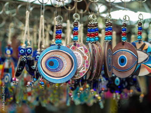 Evil eye protection amulets in a souvenir shop still life with macro effect Canvas Print