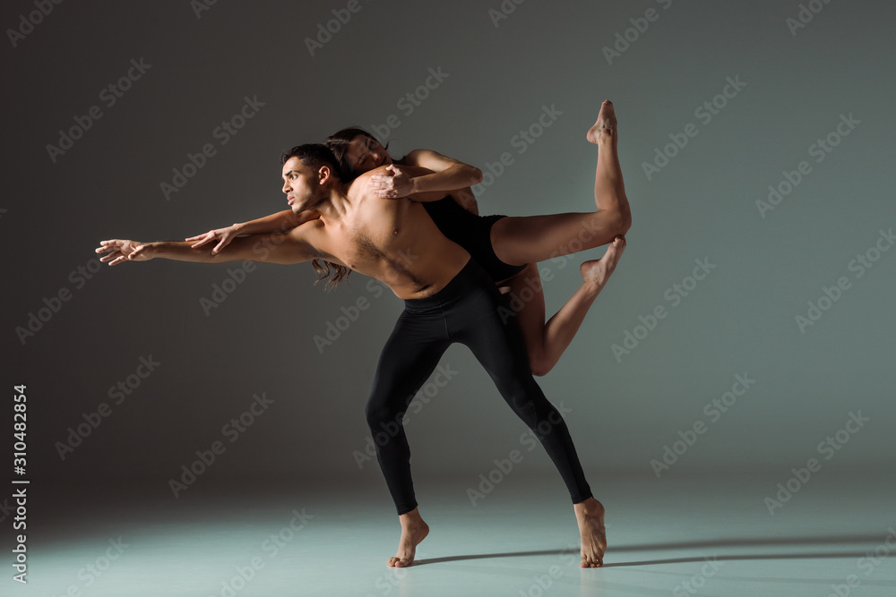 Fototapeta sexy dancers dancing contemporary on dark background with copy space