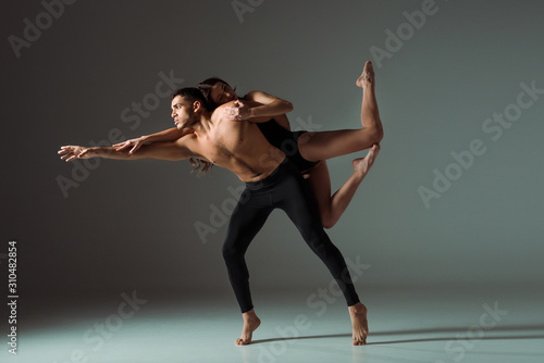 Fototapeta sexy dancers dancing contemporary on dark background with copy space obraz