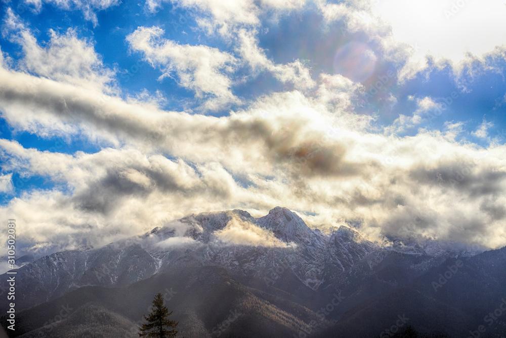 ZAKOPANE, POLAND - NOVEMBER 06, 2019: Tatra National Park in autumn. Landscape with sun and clouds in Polish Tatra Mountains early morning, Zakopane, Poland, Europe.