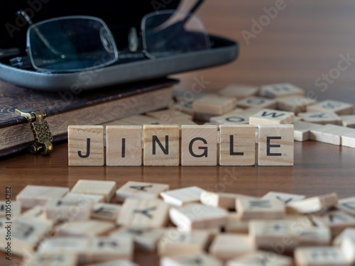 Fotografie, Tablou  jingle the word or concept represented by wooden letter tiles