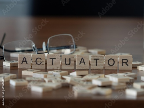 Valokuva actuator the word or concept represented by wooden letter tiles