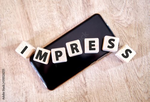 Fotografie, Tablou  Text impress on wooden cubes on a black smartphone