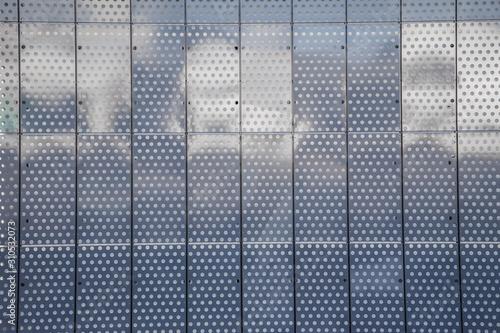 Fototapeta  Metal facade tiles background made of perforated steel