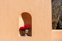 Detail Of A Nook With Bold Shadow And Christmas Poinsettia In The Historic District Of  Jekyll Island , Georgia, A Popular Southern USA Travel Destination.