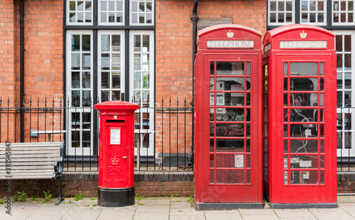 British red telephone booths beside a red post box in Stratford upon Avon, Warwi Wallpaper Mural