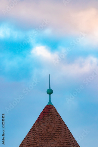 Photo Abstract artsy view of weathered finial/spire atop a shingled roof peak, against