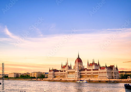 The Hungarian Parliament Building located on the Danube River in Budapest Hungary at sunset Canvas Print