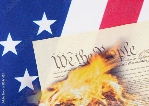 Fototapeta U.S. Constitution on flag being destroyed by fire