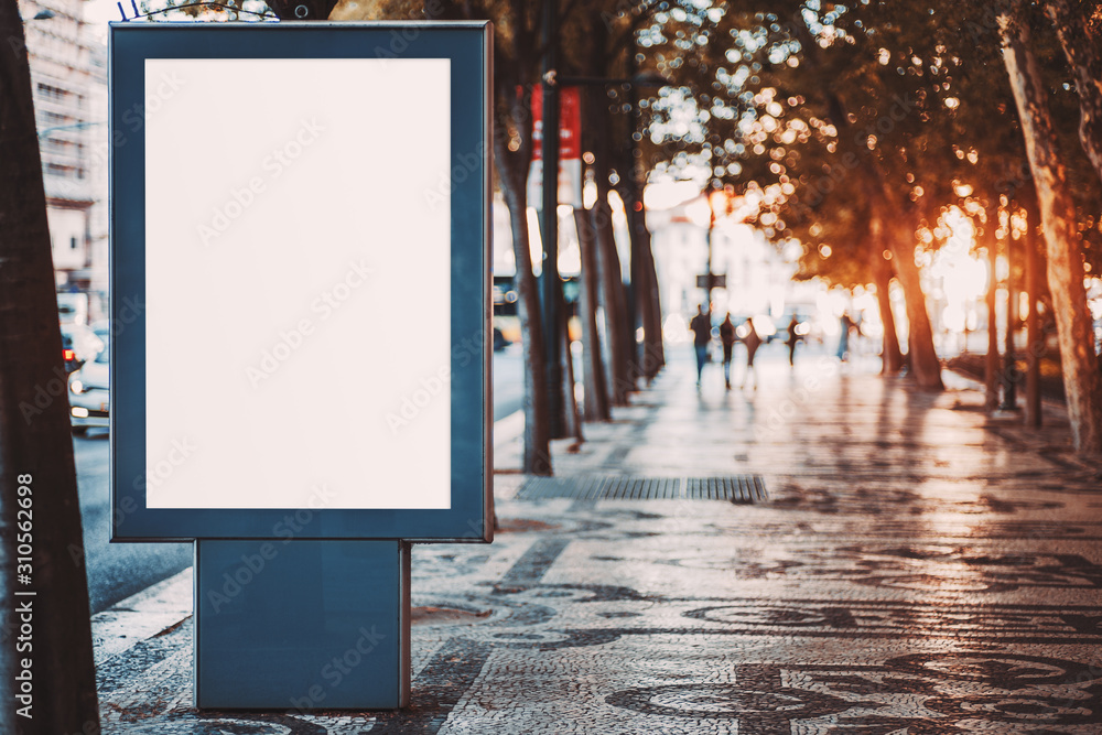 Fototapeta Outdoor mockup of a blank information poster on patterned paving-stone; an empty vertical street banner template in an alley; billboard placeholder mock-up on a city boulevard in an alleyway outdoors