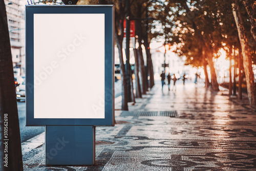 Fotomural  Outdoor mockup of a blank information poster on patterned paving-stone; an empty