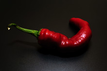 Chili Peppers On A Black Backg...