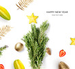 Creative happy new year card made of rosemary and fruits on the white background. Fruits happy new year, top view, festive greeting card.
