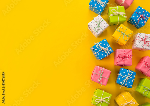 Fototapeta Colored gift boxes. yellow background. Gifts for Christmas or Birthday, Valentine's Day obraz na płótnie