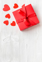 Gift To A Sweetheart On Valentine's Day. Red Present Box Near Hearts On White Wooden Background Top-down Copy Space