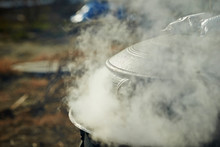 Steam Coming Out From Traditional Iron Cooking Pot
